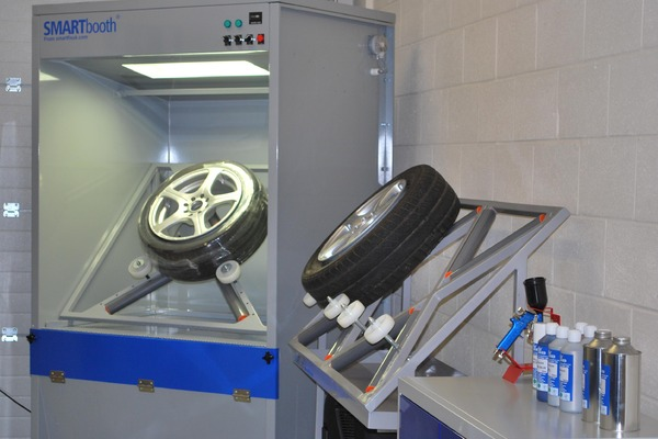 SMARTbooth in workshop with alloy wheel