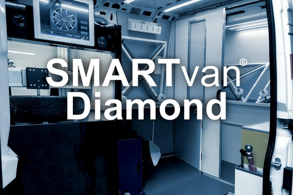 Interior view of SMARTvan Diamond including CNC lathe and alloy wheel spray booth.
